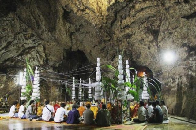 Praying within the Sacred Cave at Wat Khao Or